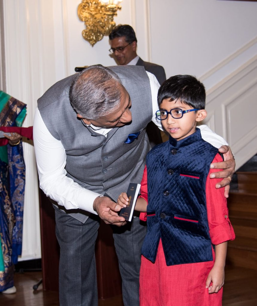 Young recipient of passport at the inauguration of Passport Seva Project by Minister of State for External Affairs V K Singh ai Indian Embassy, Washington DC (Photo courtesy: Indian Embassy, Washington DC