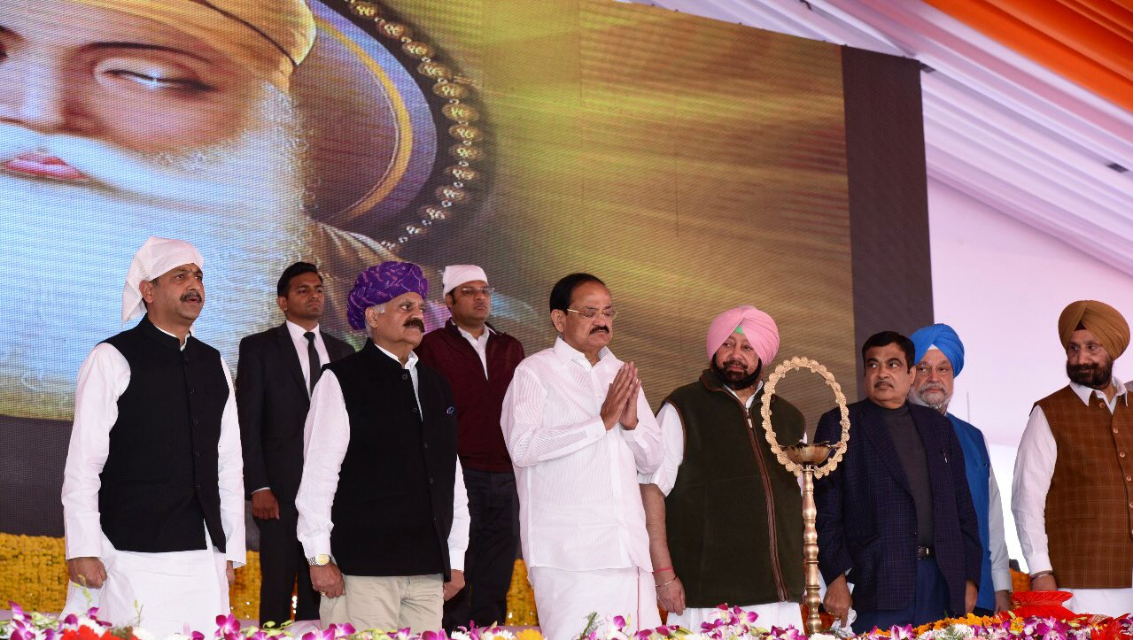 Vice-President of India Venkaiah Naidu (third from left in white attire) was present at the event to lay the foundation stone for construction of the Kartarpur Corridor. Punjab Chief Minister Captain Amarinder Singh (fourth from left) and Indian Transport Minister Nitin Gadkari (fifth from left) were also present on the occasion. Photo courtesy: Twitter@/VicePresidentOfIndia