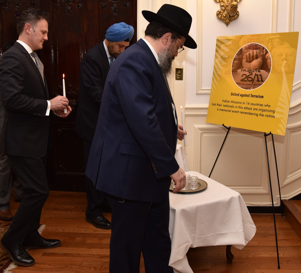 Lighting of candles by Ambassador Navtej Sarna, Ambassador-at-Large and Coordinator for Counter terrorism Nathan A. Sales, Rabbi Levi Shemstov, Executive Vice President, American Friends of Lubavitch (Chabad) at Indian Embassy, US (Photo Courtesy: MEA