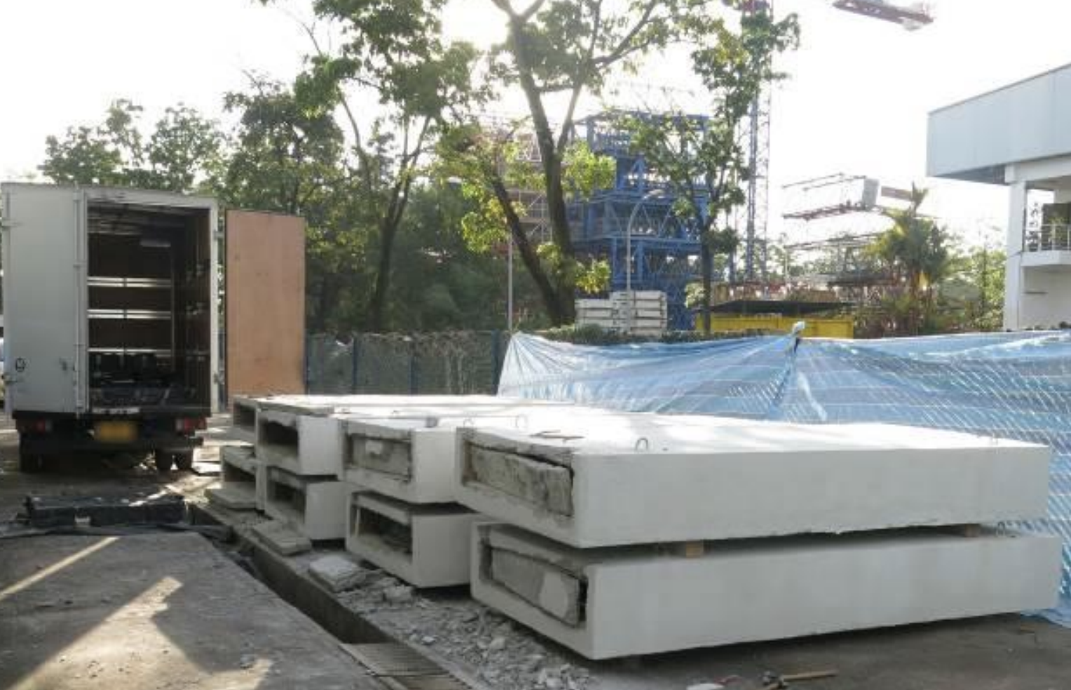 Singapore Customs officers raided a yard in Tuas Avenue 14 on 24 November 2018 and arrested four men who were retrieving duty-unpaid cigarettes that were hidden in concrete slabs and loading them onto a lorry. Photo courtesy: Singapore Customs
