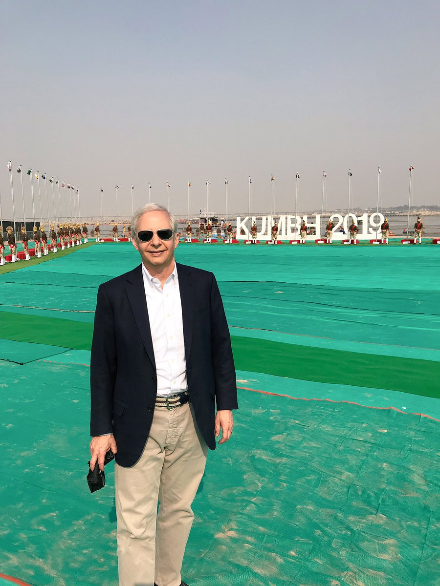US Ambassador to India Ken Juster poses in backdrop of Kumbh venue with flags of 71 nations (Photo courtesy: Ken Juster, Twitter