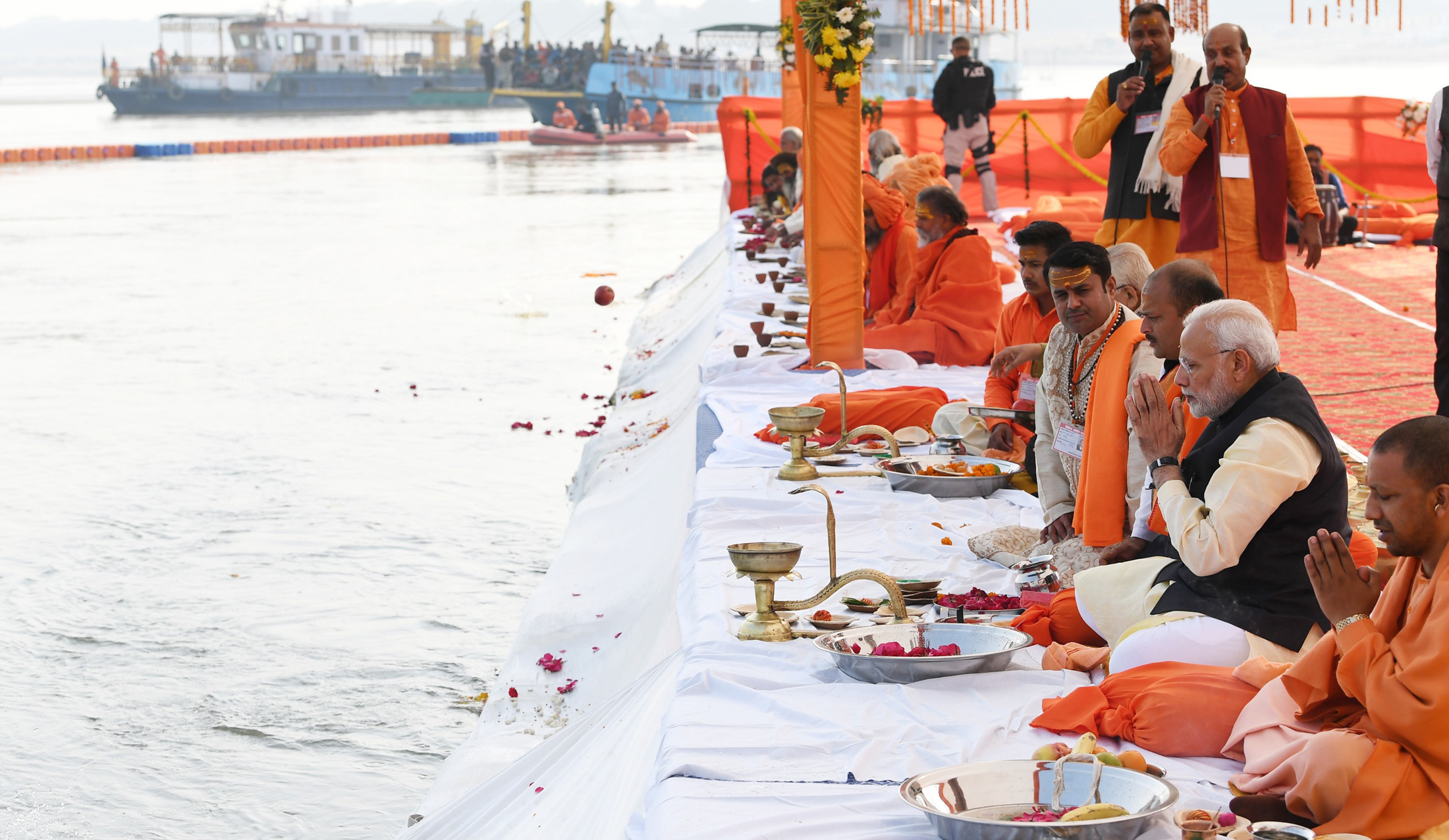 Prime Minister Narendra Modi and Chief Minister of Uttar Pradesh Yogi Adityanath performing the Ganga Pujan at Prayagraj, in Uttar Pradesh. (Photo courtesy: PIB