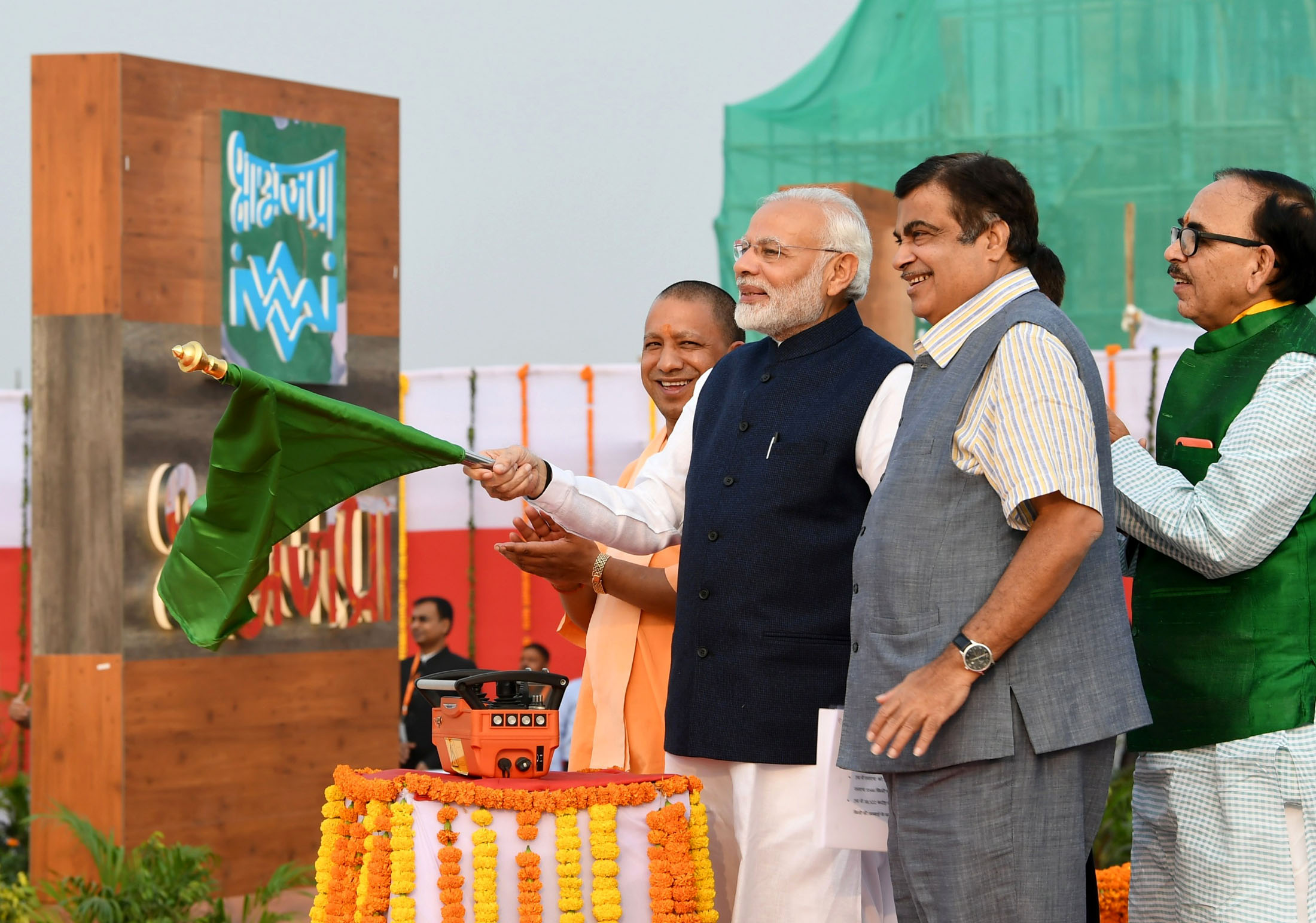 Prime Minister Narendra Modi dedicates the India's first Multi-Modal Terminal on river Ganga to the nation, in Varanasi, Uttar Pradesh on November 12. Minister for Road Transport & Highways, Shipping and Water Resources, River Development & Ganga Rejuvenation Nitin Gadkari and the Chief Minister of Uttar Pradesh Yogi Adityanath are also seen. Photo courtesy: Press Information Bureau