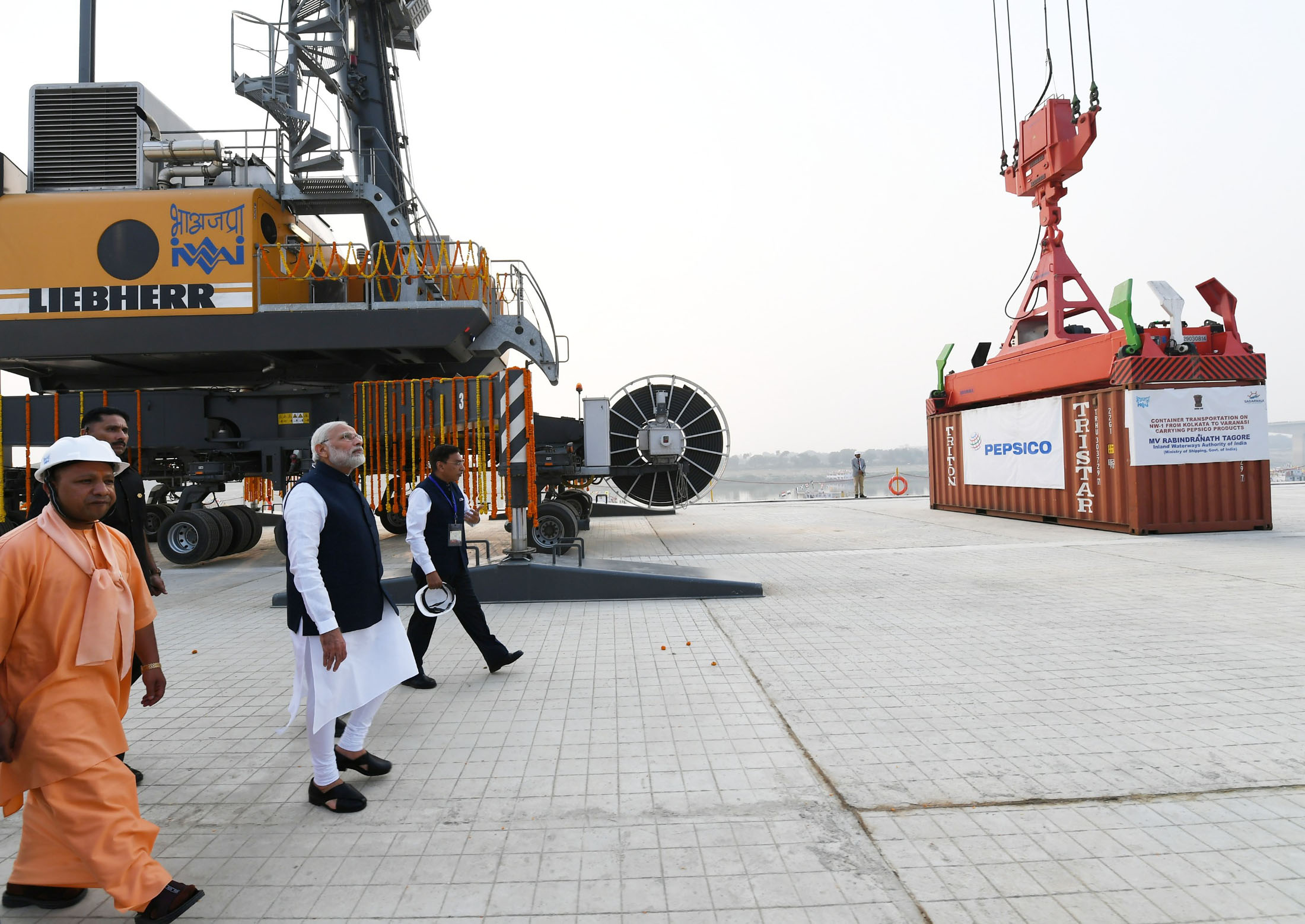 Prime Minister Narendra Modi dedicates the India's first Multi-Modal Terminal on river Ganga to the nation, in Varanasi, Uttar Pradesh on November 12. Chief Minister of Uttar Pradesh Yogi Adityanath are also seen. Photo courtesy: Press Information Bureau