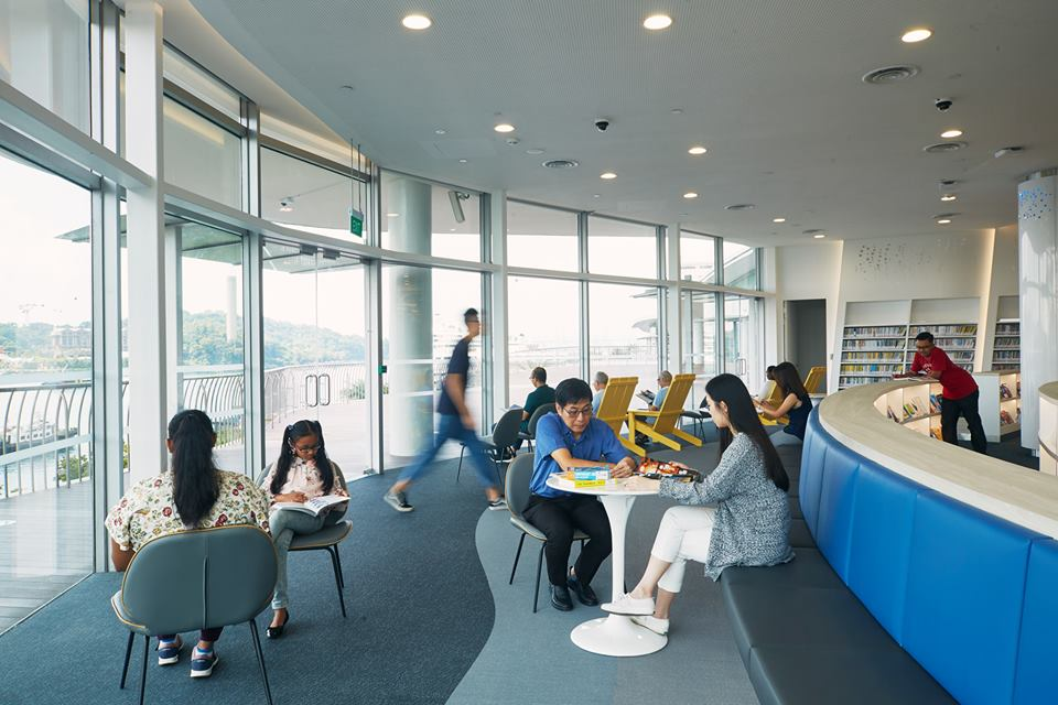Visitors can enjoy the magnificent beauty of Sentosa while sitting at the new library@harbourfront at VivoCity. Photo courtesy: Facebook page of  National Library Board