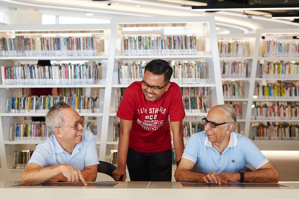 Adults and teens can connect with current affairs by reading eNewspapers at the library. Photo courtesy: Facebook page of  National Library Board