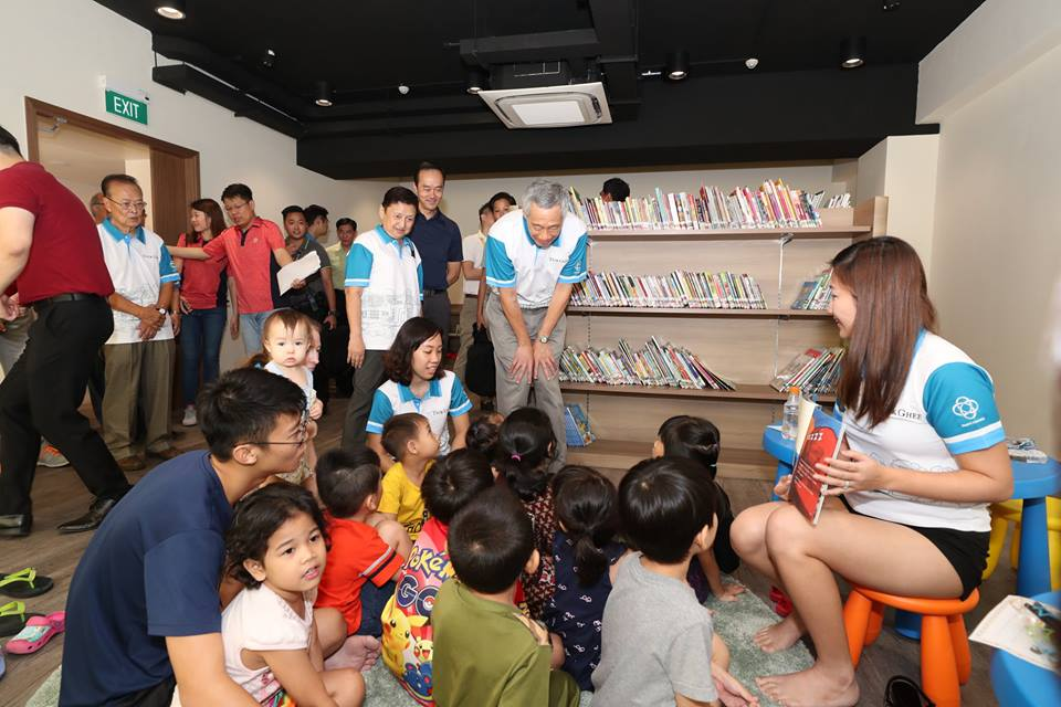 Teck Ghee Community Club also has a cosy corner for little ones to read. PM Lee stading in the middle of a kidsREAD session. Photo courtesy: Facebook page of PM Lee