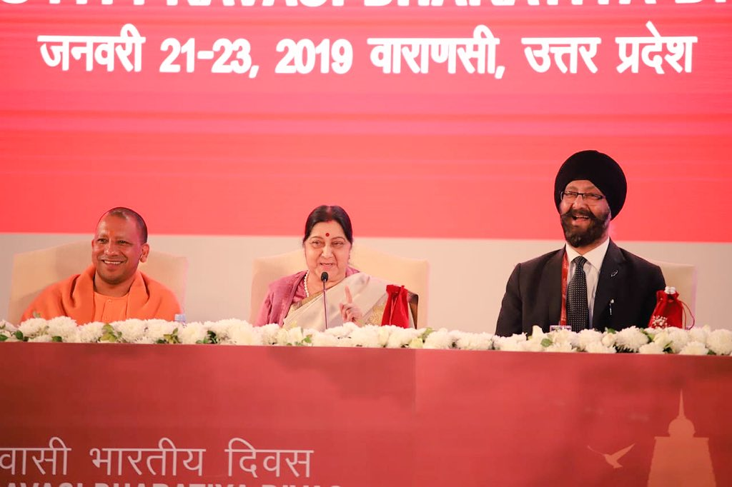 UP Chief Minister Yogi Adiyanath,  New Zealand MP Kanwaljit Singh Bakshi and Minister of External Affairs Sushma Swaraj share a lighter moment with audience at Pravasi Bhartiya Divas 2019 in Varanasi. Photo courtesy: PBD Convention