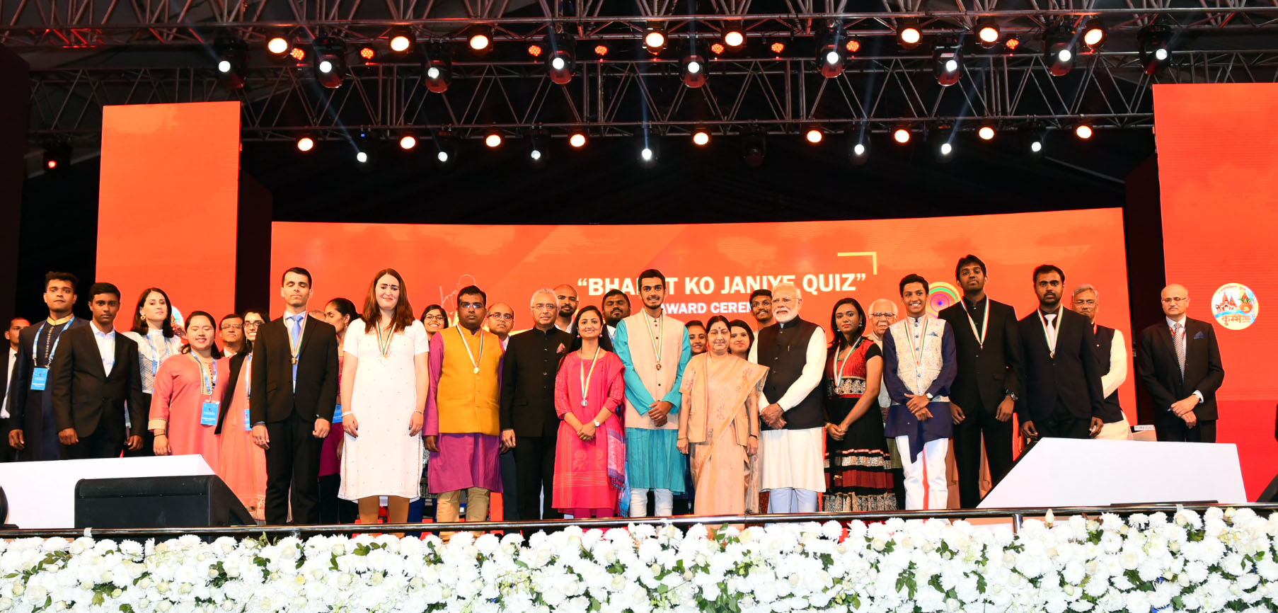 Prime Minister Narendra Modi with the winners of Know India Quiz, at the inauguration of the 15th Pravasi Bharatiya Divas convention 2019 in Varanasi. Prime Minister of Mauritius Pravind Jugnauth, the Minister for External Affairs Sushma Swaraj and other dignitaries are also seen. Photo courtesy: PMO