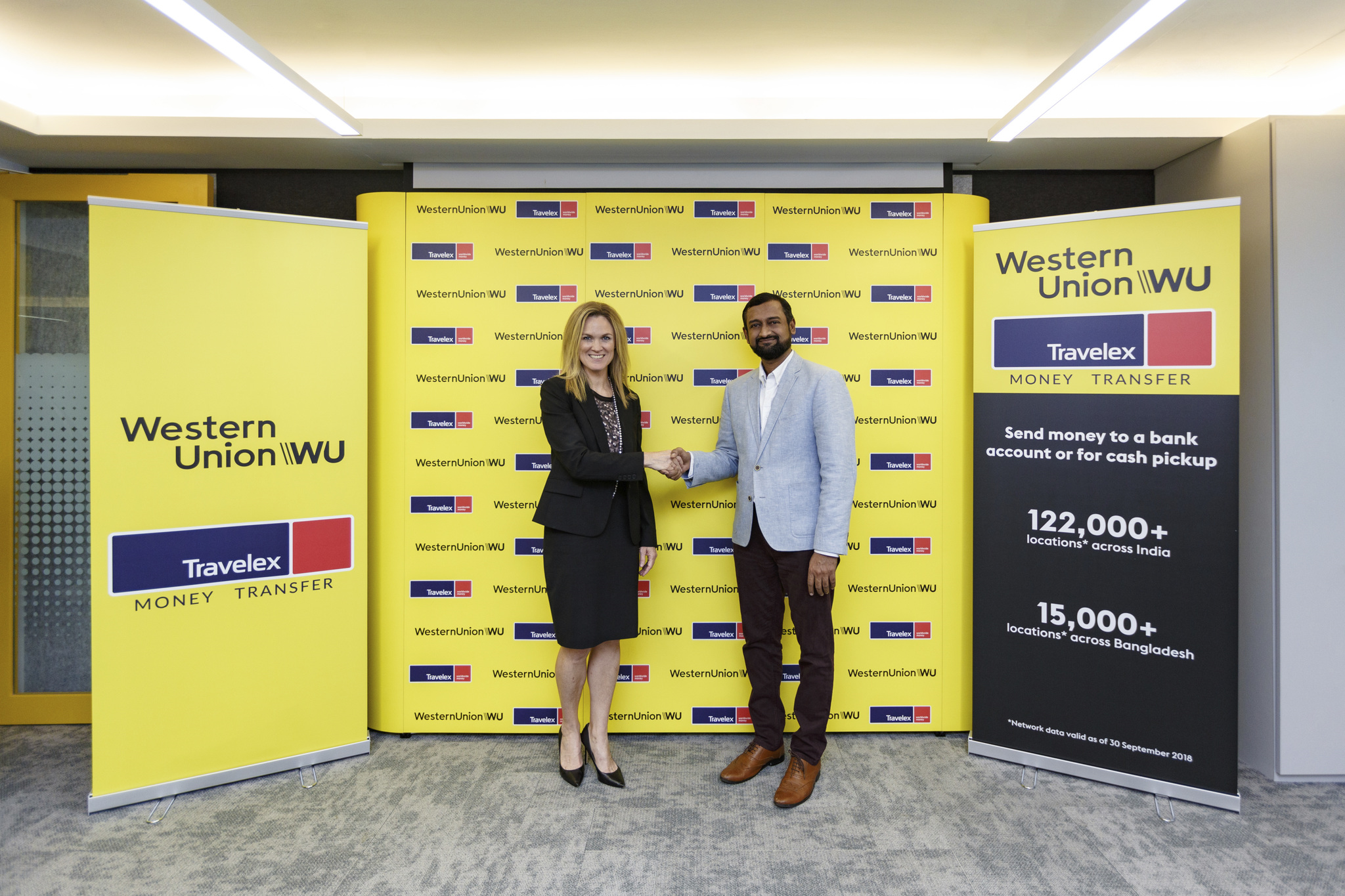 Molly Shea, Senior Vice President and General Manager, Global Money Transfer, Asia Pacific, Western Union and Lakskmi Narayan S, Travelex's Global Head of Remittances sealing the deal on behalf of the two companies which will help co-locating Western Union money transfer services within worker dormitories across Singapore. Photo courtesy: Western Union