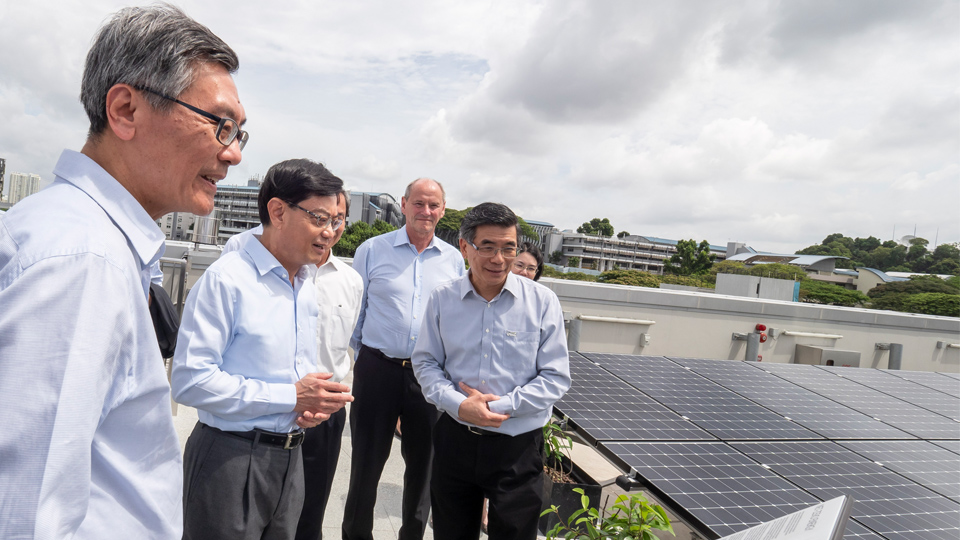 Mr Heng Swee Keat, Minister for Finance and Chairman of the National Research Foundation, viewing the rooftop photovoltaic panels at SDE4, Singapore's first new-build net-zero energy building. Photo courtesy: NUS