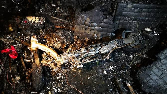 The charred remains of the burnt e-scooter which caused a fire at the sixth-floor flat on 132 Cashew Road in Singapore. Photo courtesy: SCDF