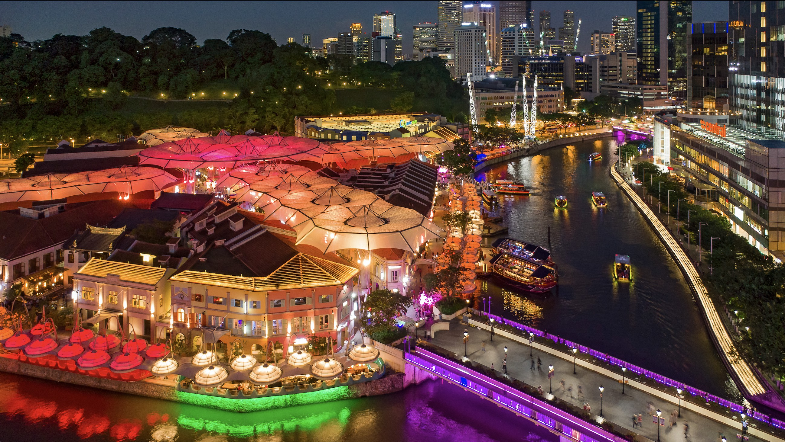Nighttime aerial image of Clarke Quay, with lights, Singapore River, Fort Canning and civic district in the background. Photo courtesy: Lim Wei Xiang/STB