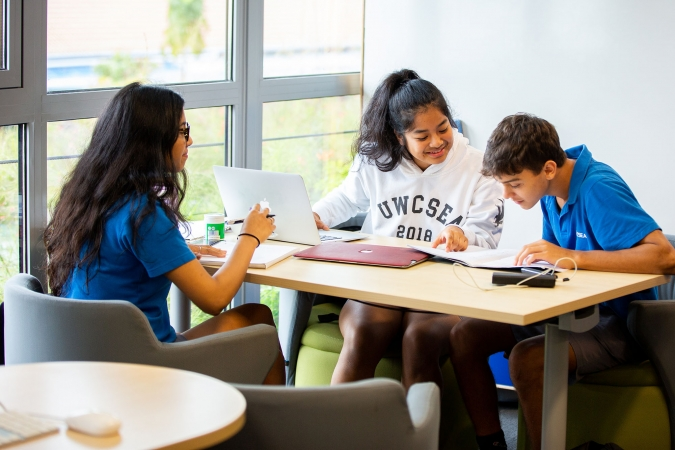 Students studying in High School library of the Dover Campus of United World College of South East Asia. Photo courtesy: UWCSEA