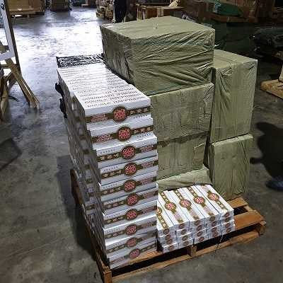 The seized contraband of cigarettes which were concealed within specially-hollowed game machines. Photo courtesy: ICA