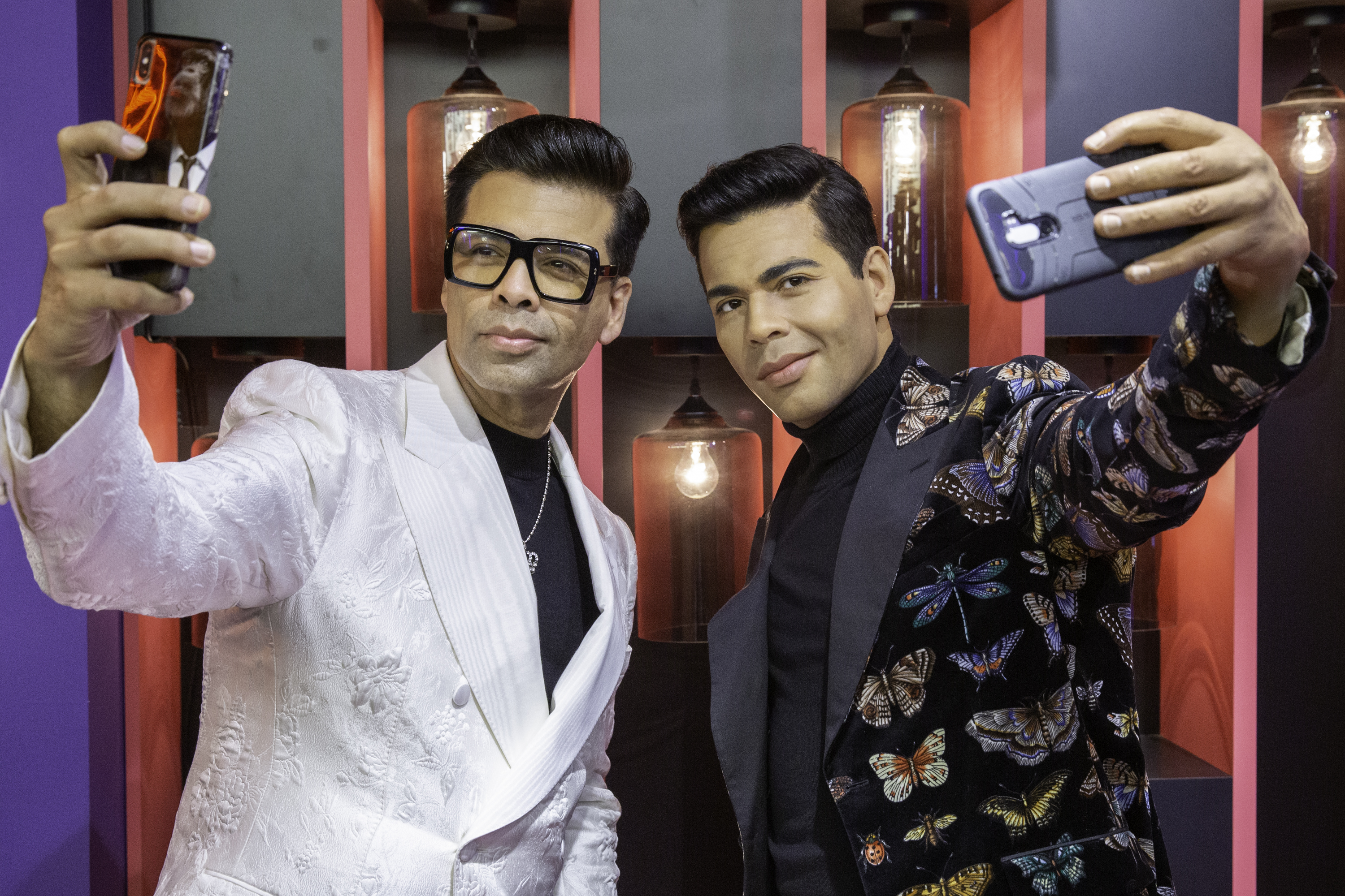 Karan Johar posing with his wax statue, which is a star attraction in multiple scenarios of the Bollywood Experience at Madame Tussauds Singapore. Photo courtesy: MAdame Tussauds