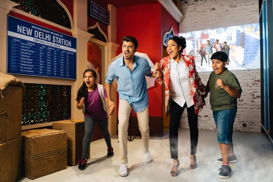 Bringing to life a classic scene from Indian cinema, fans find themselves in a traditional railway train station in the midst of a digitally generated earthquake made possible with AR technology, audio-visual effects and real-time camera capture. Photo courtesy: Madame Tussauds