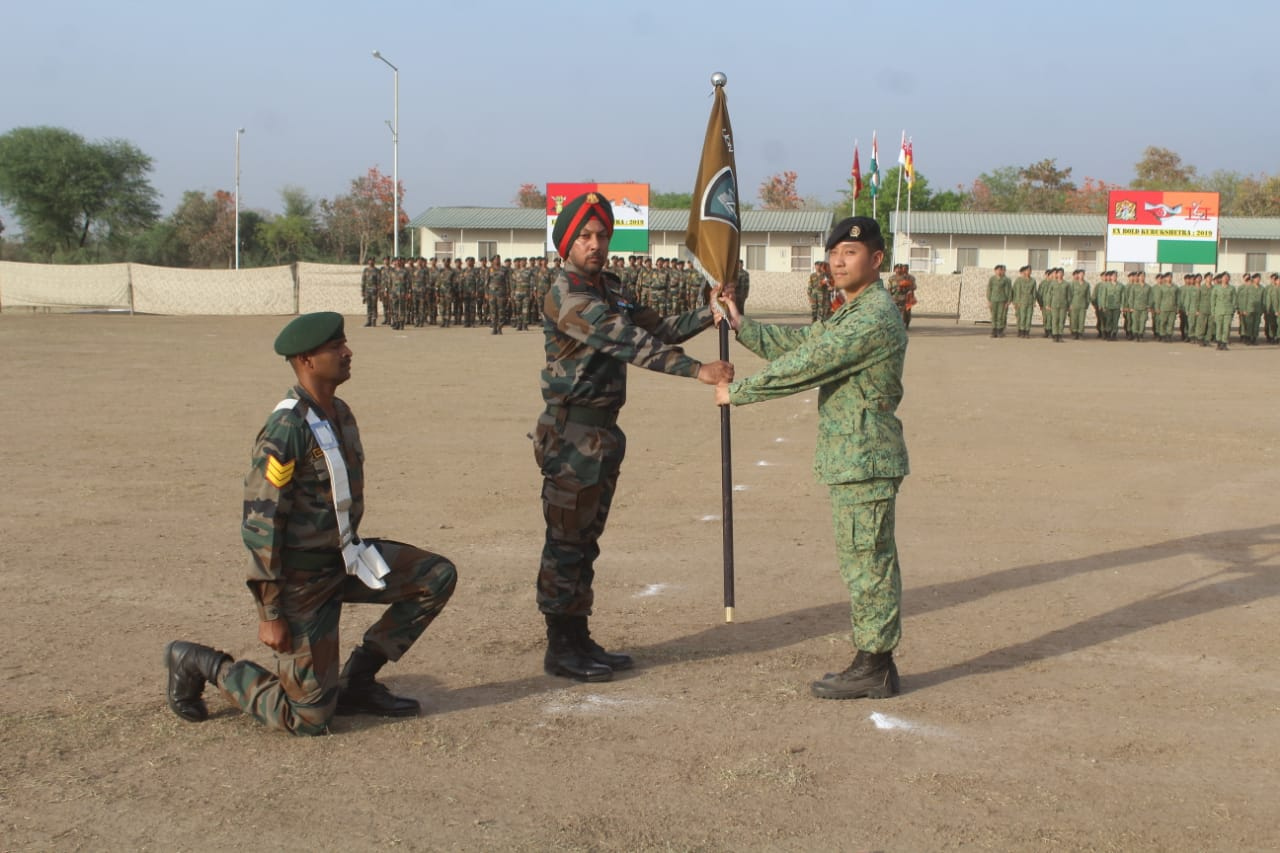 Handing over of ceremonial flag taking place at the opening ceremony of India-Singapore joint army exercise at Babina Military station near Jhansi in the Indian State of Uttar Pradesh. Photo courtesy: Ministry of Defence, India