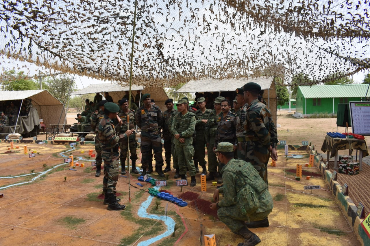 Indian and Singapore army officers holding joint sand model discussion during the joint army exercise. Photo courtesy: Ministry of Defence, India