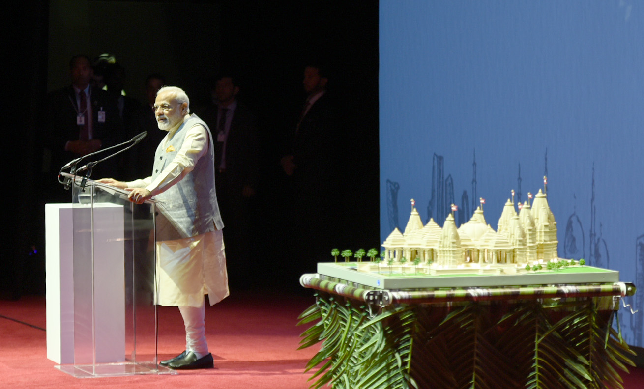 Prime Minister Narendra Modi, with replica of temple on his side, addressing the Indian community at the iconic Dubai Opera, in Abu Dhabi, United Arab Emirates on February 11, 2018. Photo courtesy PMO