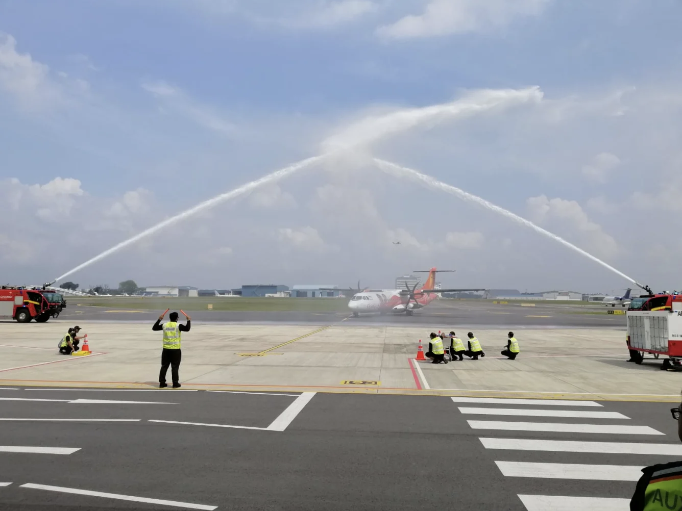 FY3126 welcomed with a water canyon salute on its inaugural flight into Seletar Airport. Photo courtesy: Changi Airport Group