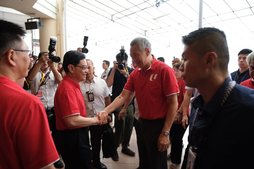 Prime Minister of Singapore Lee Hsien Loong shake hands with Deputy Prime Minister of Singapore Heng Swee Keat at the NTUC May Day Rally. Photo courtesy: Facebook page of PAP