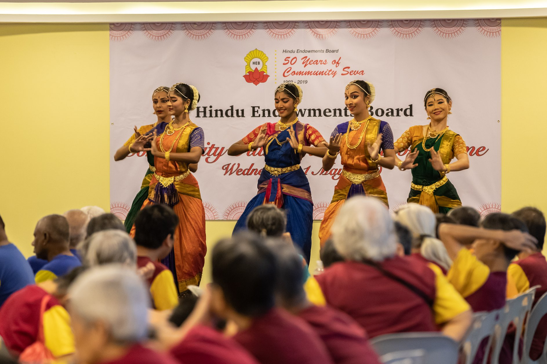 Residents at Sunlove Home enjoying an Indian dance performance. Photo courtesy: Hindu Endowments Board
