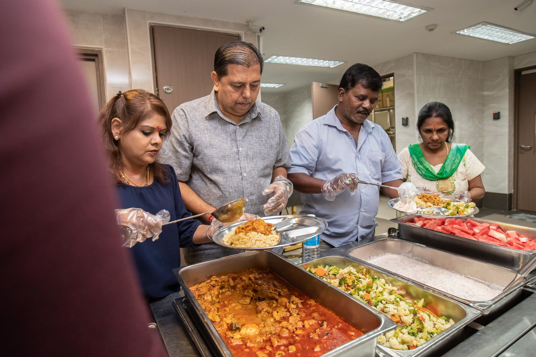 Volunteers from the Sri Mariamman Temple served lunch to residents at Sunlove Home. Photo courtesy: Hindu Endowments Board