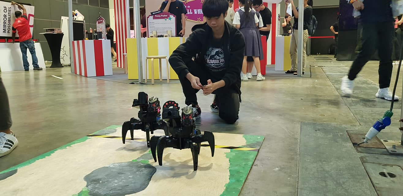 A young visitor trying out the drones at Tech Saturday 2018. Photo courtesy: IMDA