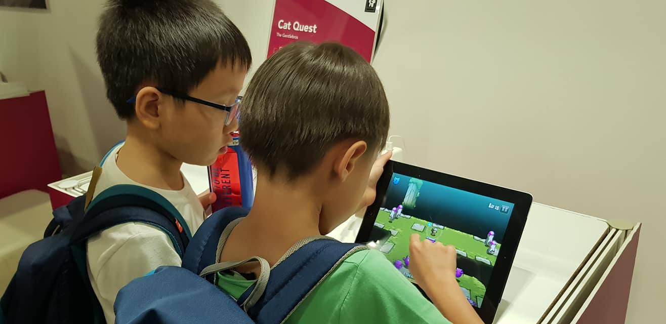 Boys having fun with the interactive games at Tech Saturday 2018. Photo courtesy: IMDA
