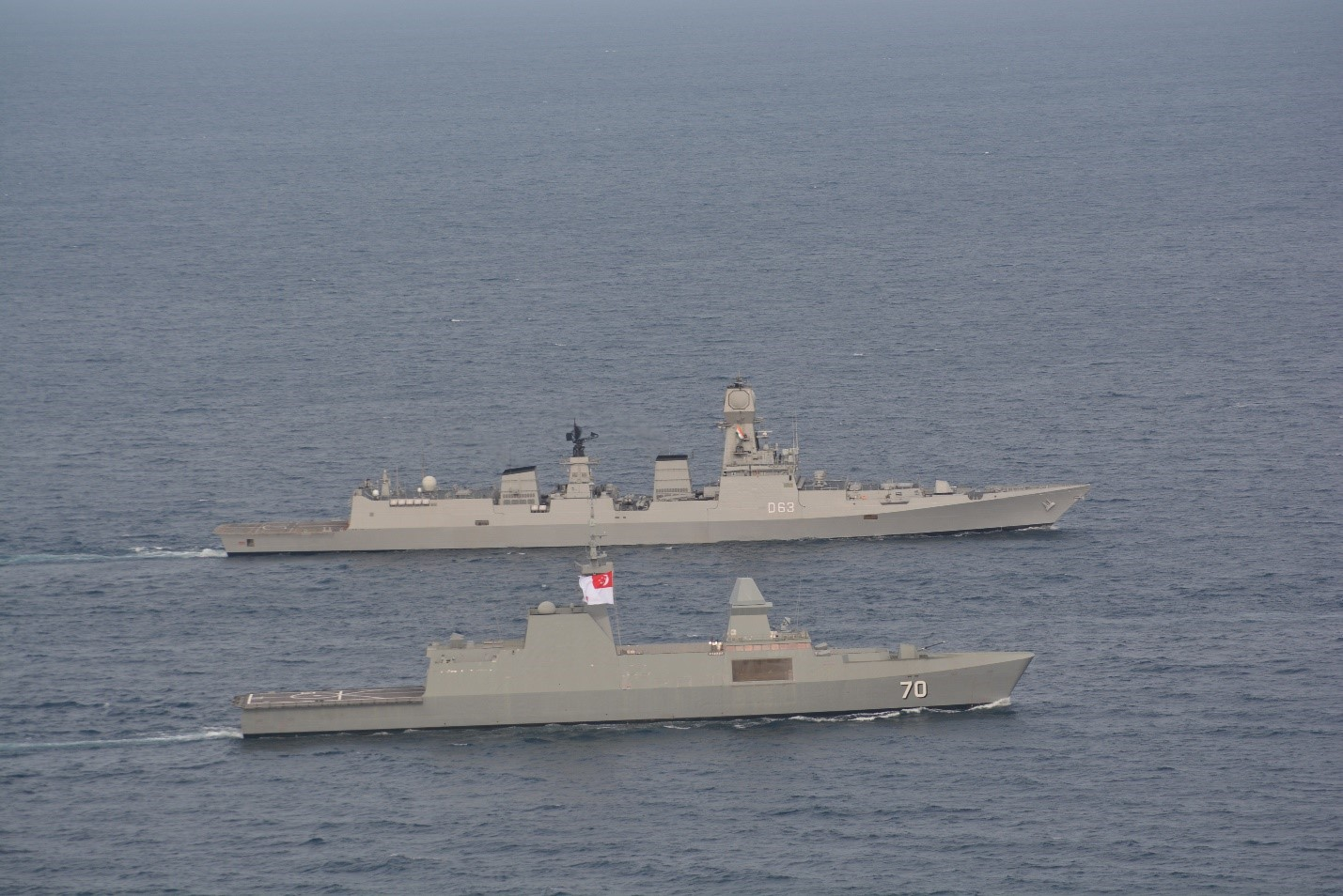 INS Kolkata and RSS Stadfast are undertaking a close manoeuvre in this picture. Indian Navy and Republic of Singapore Navy conduct annual naval exercise SIMBEX 2019 in South China Sea. Indian Navy Ships Kolkata and Shakti took part in the exercise, along with submarine hunter and surveillance aircraft Poseidon P8I. Photo courtesy: HCI Singapore