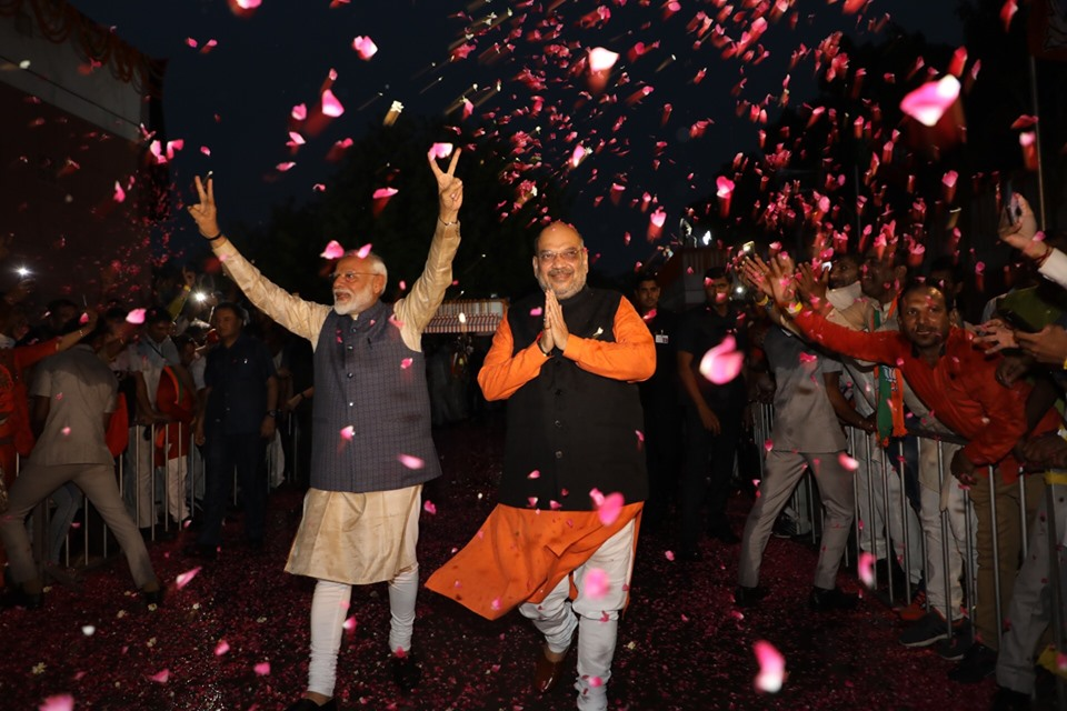 Flowers being showered on Indian Prime Minister Narendra Modi and BJP president Amit Shah for the party's remarkable victory in the Lok Sabha elections. Photo courtesy: Twitter@/BJP4India