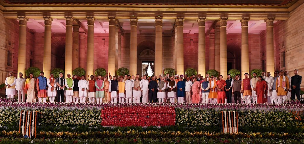 PM Modi with his new Council of Ministers and President Kovind after the oath-taking ceremony. Photo courtesy: Twitter/@narendramodi