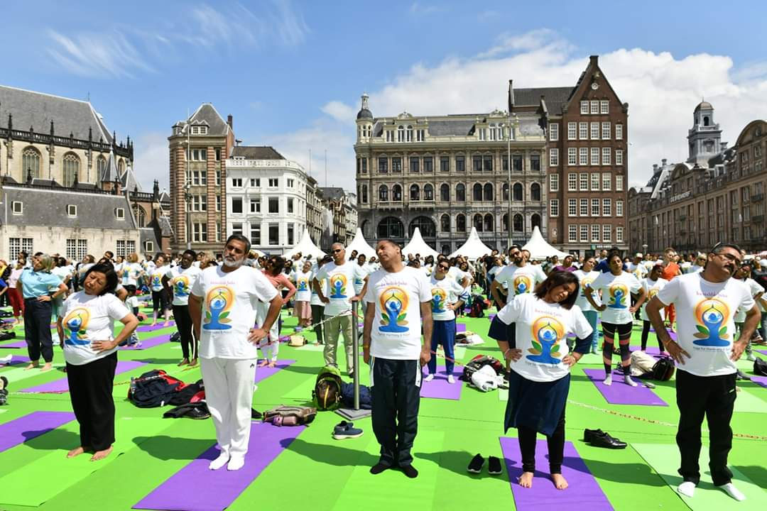 International Day of Yoga 2019 celebrations in the iconic Dam Square in Amsterdam organised by the Embassy of India in the Netherlands, featuring yoga sessions, Indian handicrafts and dance and music. Photo courtesy: Twitter/@IndinNederlands