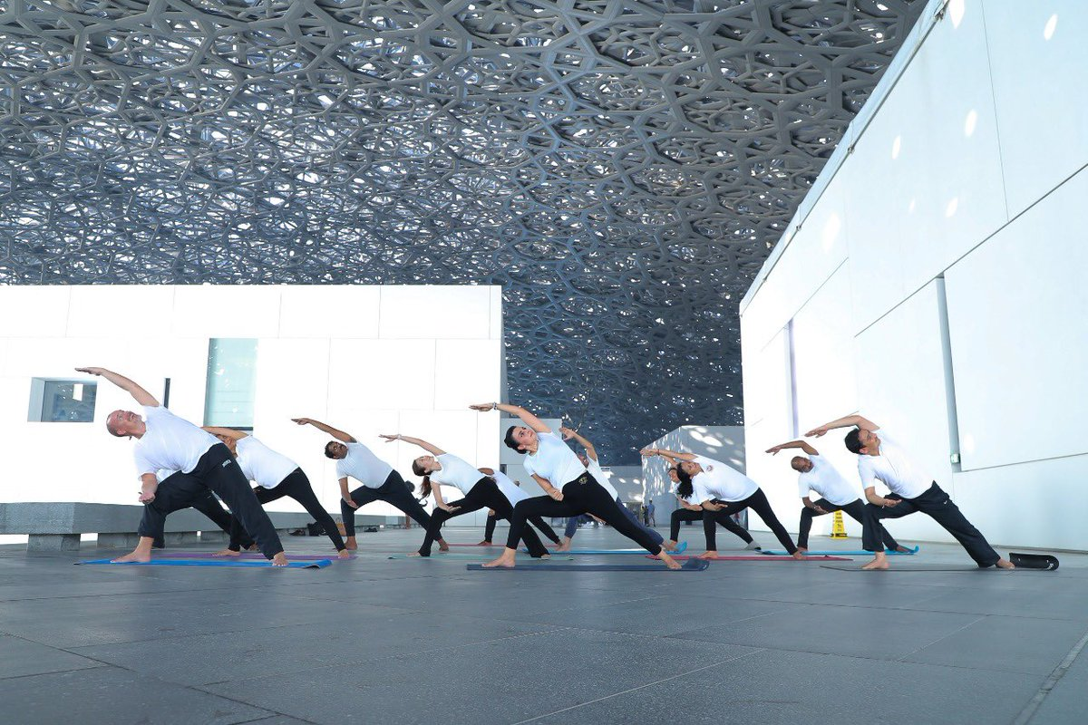 In the run-up to the upcoming Yoga Day 2019 celebrations, yoga enthusiasts performing at the iconic Louvre, Abu Dhabi. Photo courtesy: Twitter/@IndembAbuDhabi