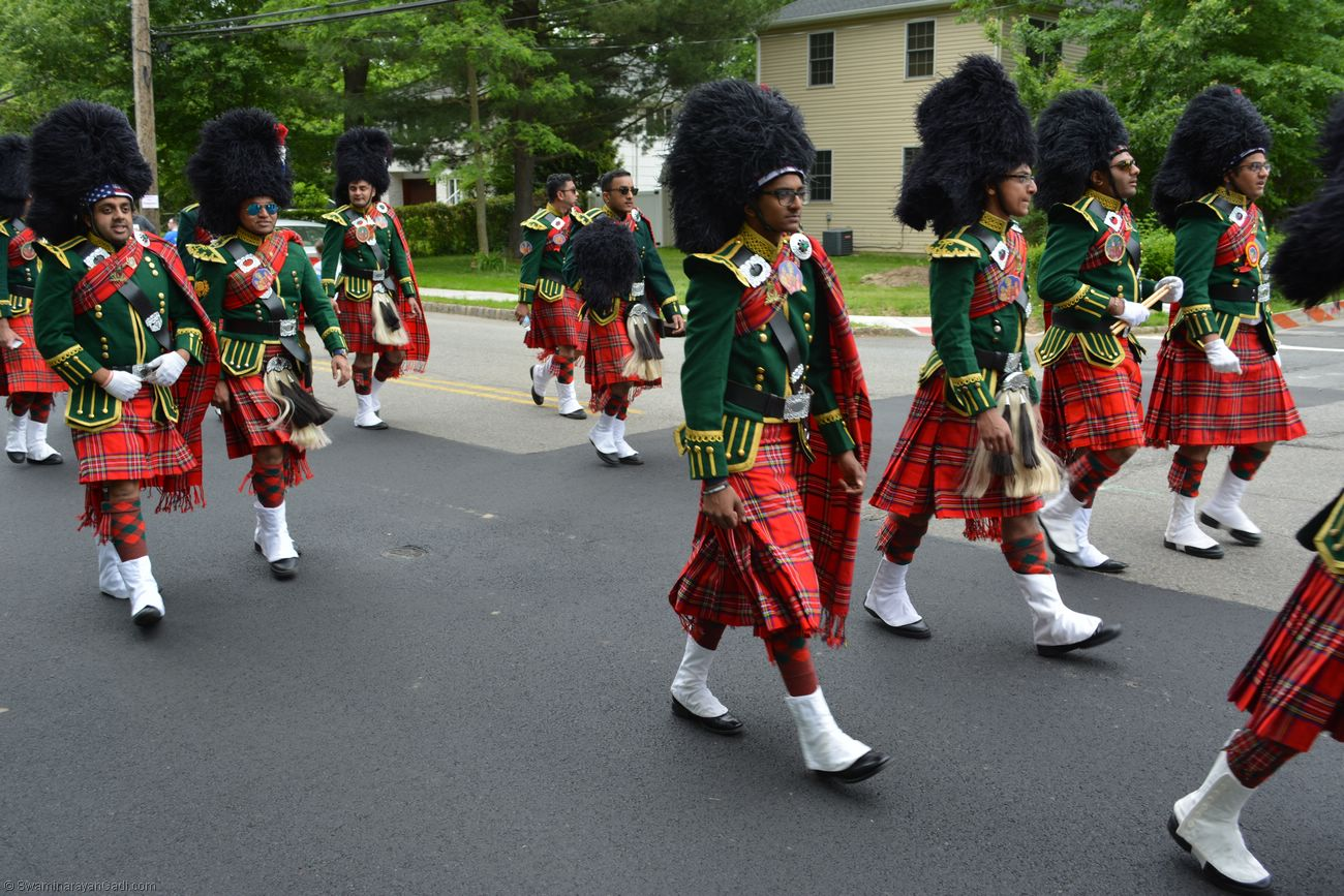 The Swamibapa Band members walk through streets with a pep in their step   (source: MSSGS