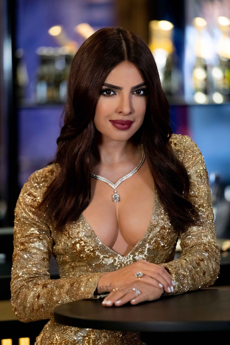 Styled to match the actress' appearance at the 2017 Golden Globes, Priyanka's figure in London will be clothed in a gold sequin gown