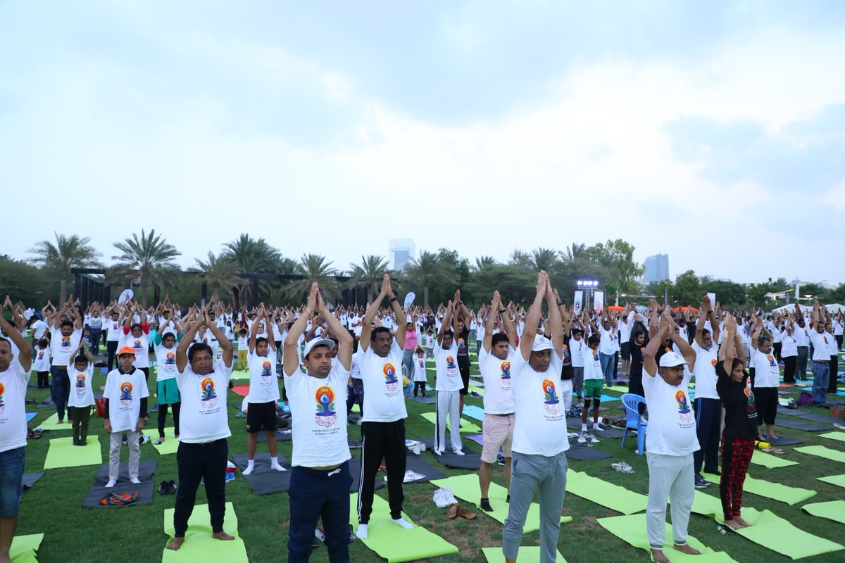 People across all age groups performing yoga asanas on mats in Abu Dhabi to mark the International Day of Yoga. Photo courtesy: Twitter/@IndembAbuDhabi