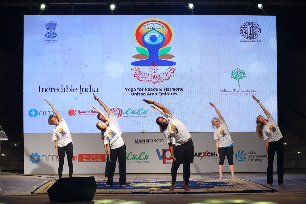 Yoga experts teaching intricacies of yoga exercises to the people at Abu Dhabi. Photo courtesy: Twitter/@IndembAbuDhabi
