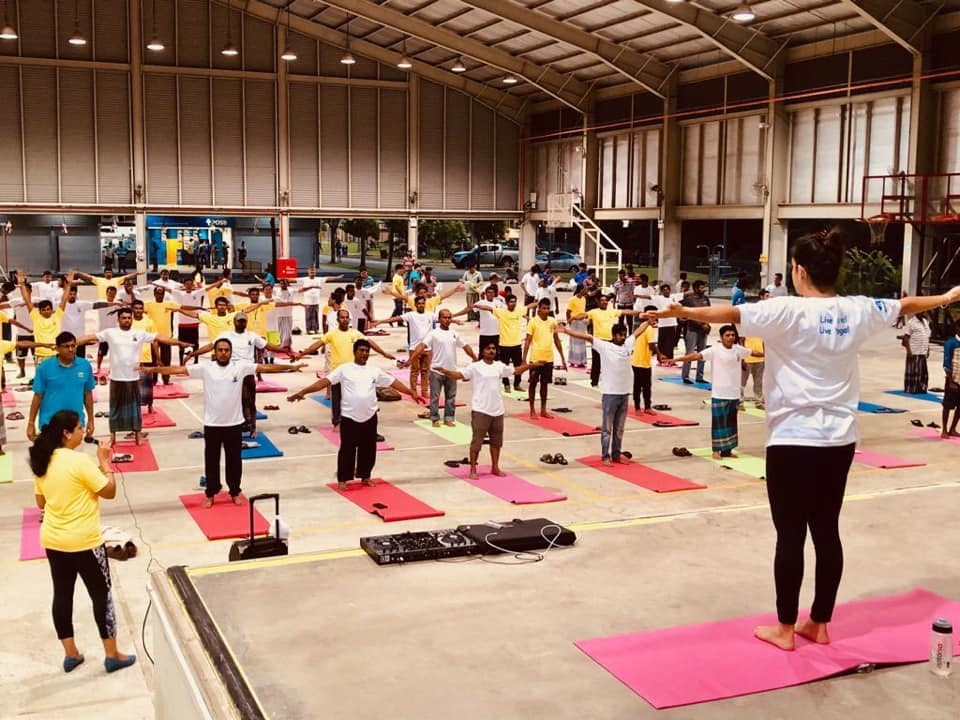 Migrant workers joined in the yoga session at the Penjury Recreation Centre for Migrant Workers. Photo courtesy: High Commission of India, Singapore