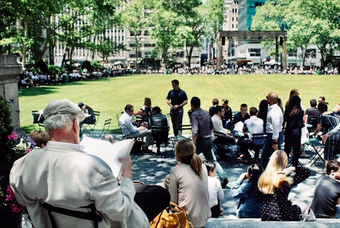 Professor reviewing his academic textbook in Bryant Park before his lecture. Photo courtesy: Kaustubh Shankar