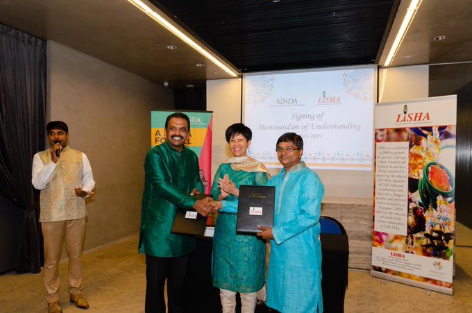 (from left) SINDA's Anbarasu Rajendran, Second Minister for Finance & Education Indranee Rajah and chairman of LISHA Rajakumar Chandra.