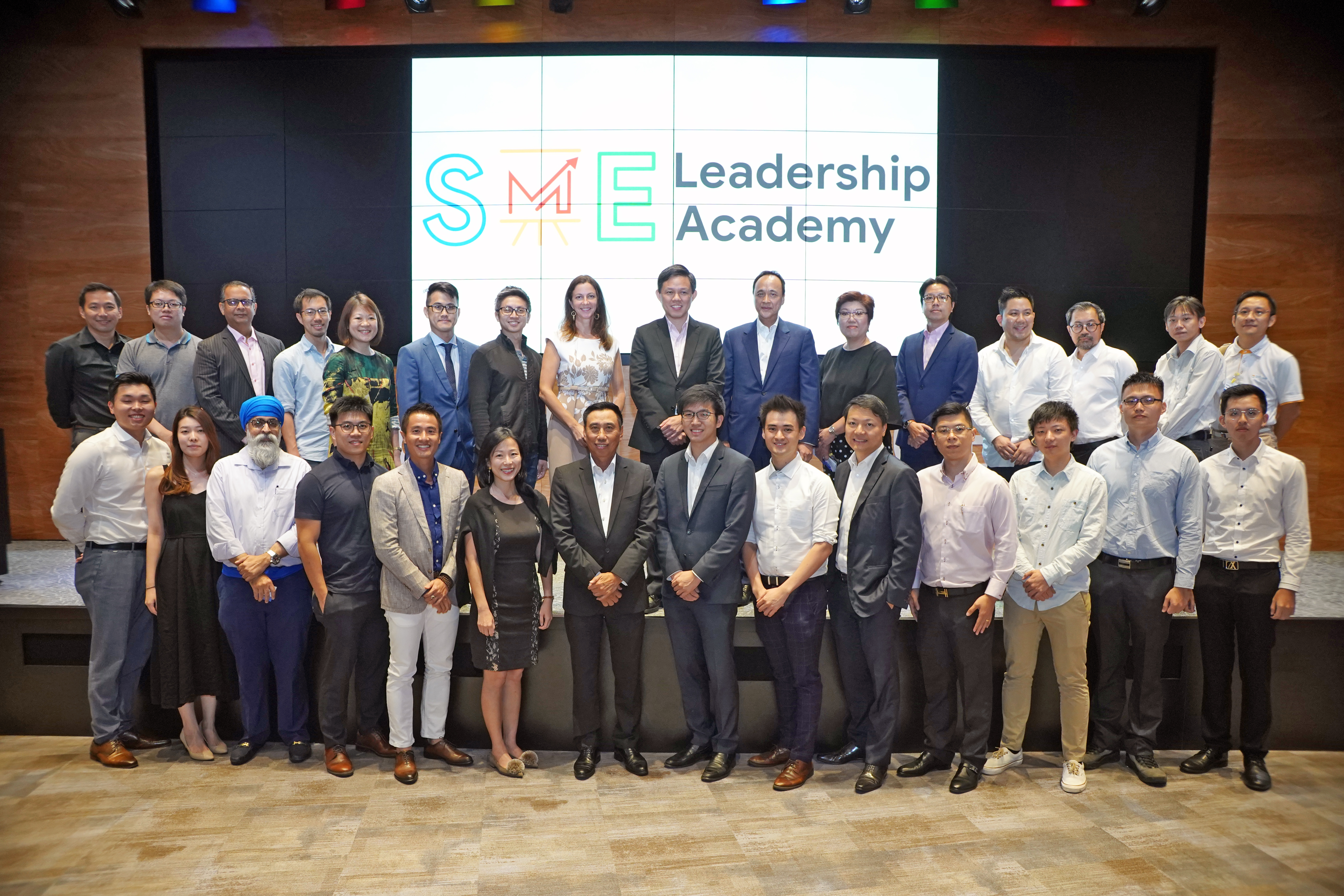 Chan Chun Sing, Minister for Trade and Industry; Stephanie Davis, MD, Google SEA;  Frederick Chin, Head of Group Wholesale Banking and Markets, UOB; and graduates from the pilot cohorts of the SME Leadership Academy.  Photo courtesy: Google