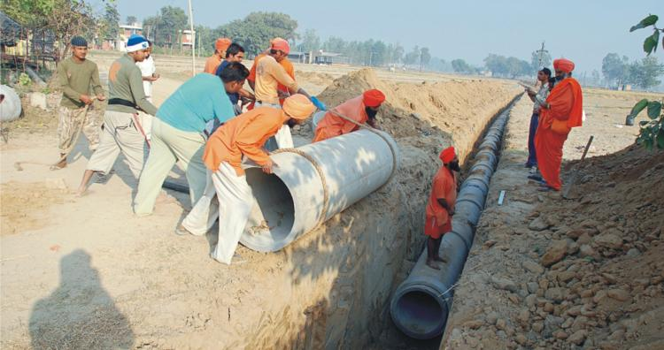 a sewer system was being installed on the lines of the 'Seechewal Village Model'