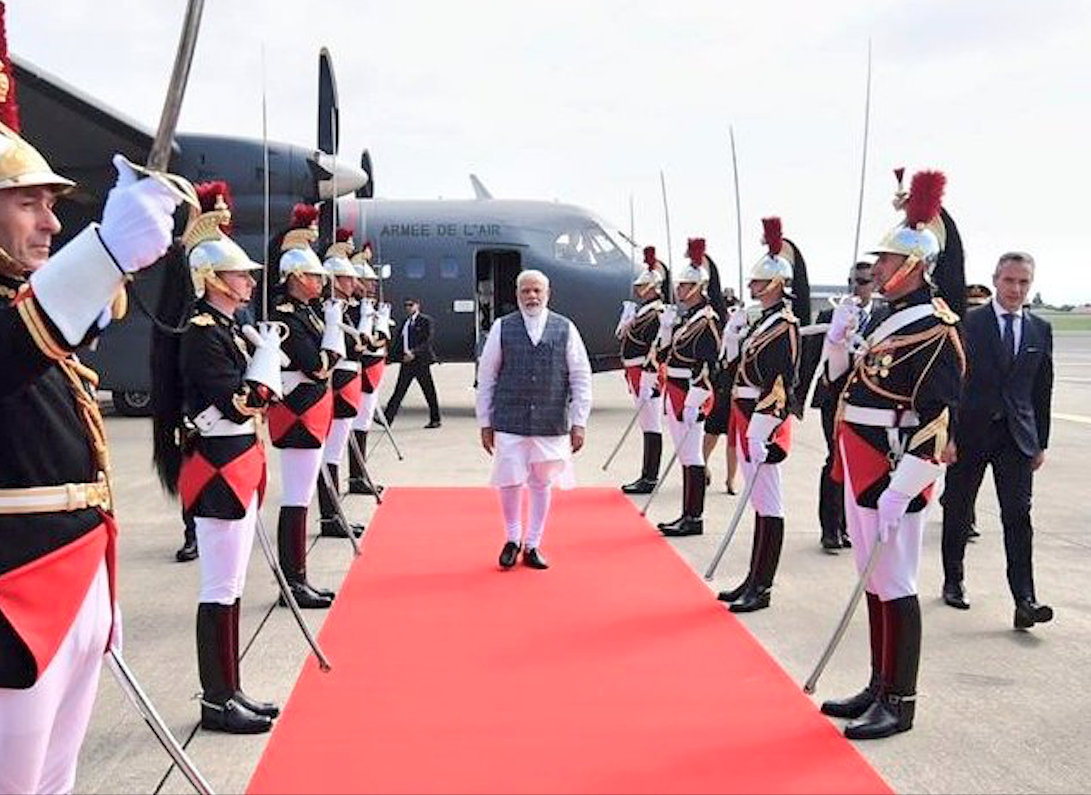Modi is attending G7 on the invitation of French President Emmanuel Macron. Photo courtesy: Twitter/@MEAIndia