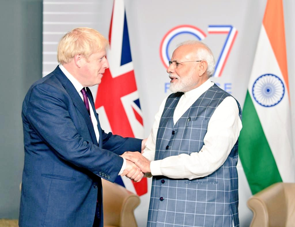 Johnson (left) stated that the two nations had planned to cooperate in other areas. Photo courtesy: Twitter/@MEAIndia