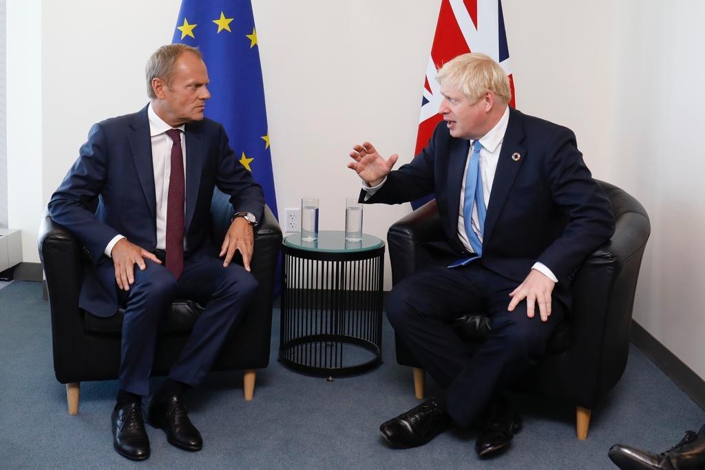 Boris Johnson (right) with EU Council President Donald Tusk (left). File photo courtesy: Twitter/@eucopresident