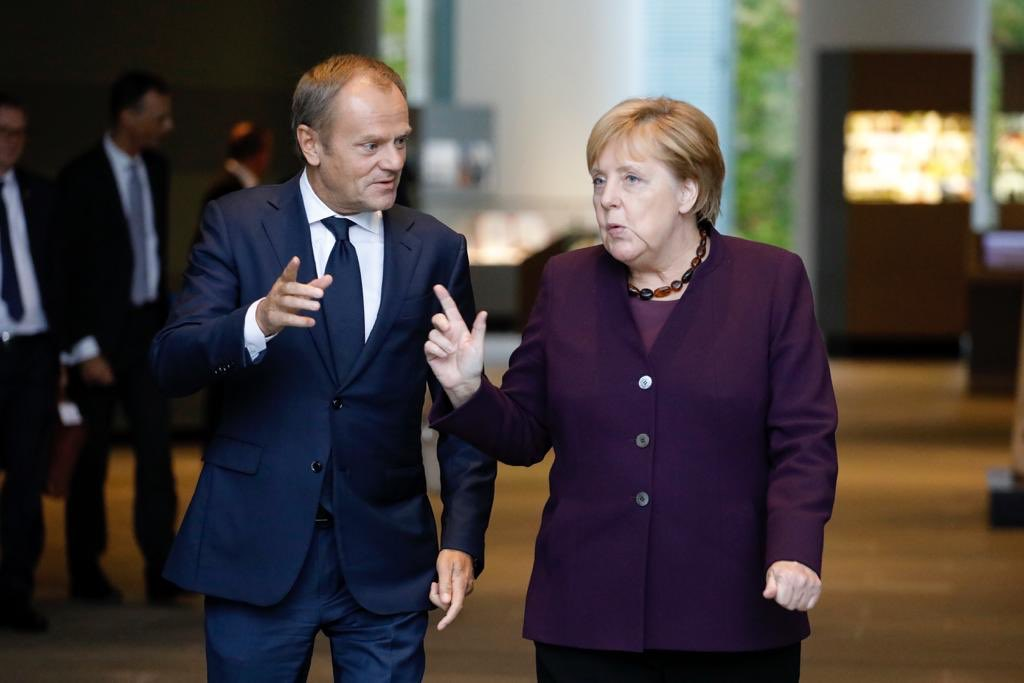 EU Council President Donald Tusk with German Chancellor Angela Merkel. Photo courtesy: Twitter/@eucopresident