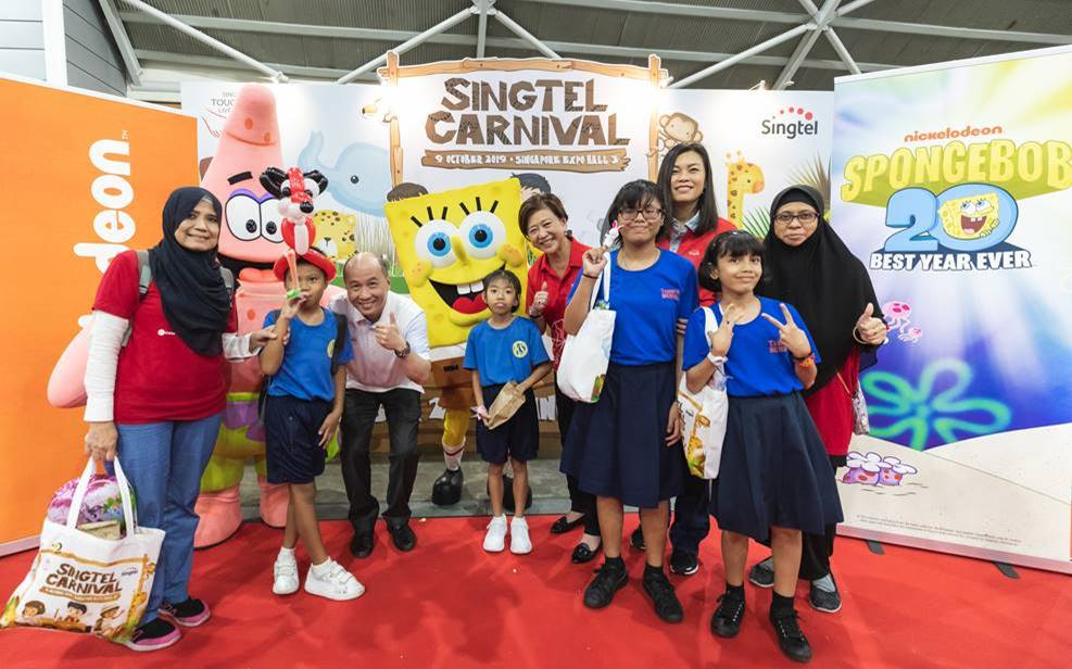 Members of Singtel's management including Yuen Kuan Moon, Chairman of the STLF and CEO Consumer Singapore (standing, third from left), Group CEO Chua Sock Koong (standing, fifth from left) and special needs students enjoy a photo moment with SpongeBob SquarePants and Patrick Star. Photo courtesy: Singtel