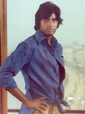 Amitabh Bachchan in a scene from Deewar (1975). 'The blue-shirt man' would go on to become one of his most famous roles. Photo courtesy: Forbes